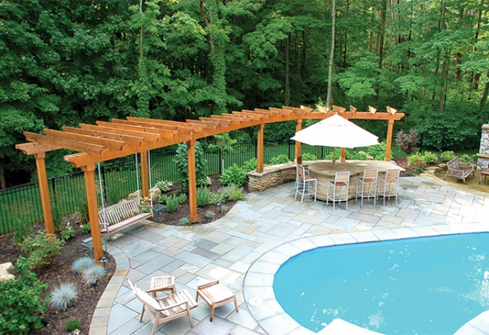 A natural stained cedar arbor and hightop seating area.