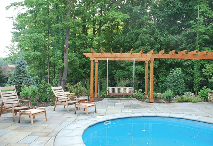 Arbor with swing and perennial gardens.