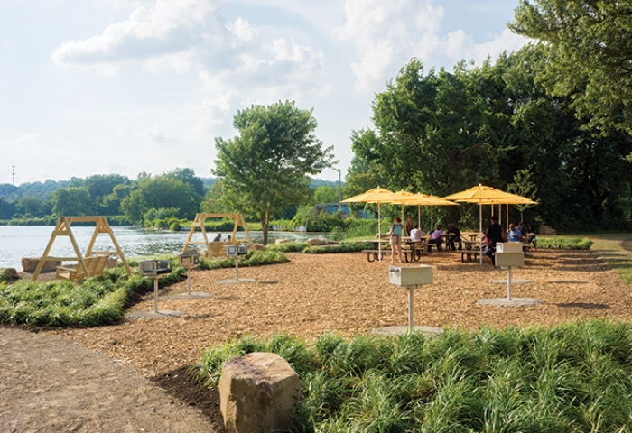 Lakeside gathering areas with picnic tables, grills, fire rings & swings.