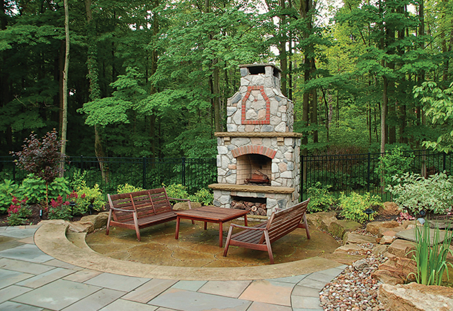 Sunken sandstone patio with Masonry Fireplace.