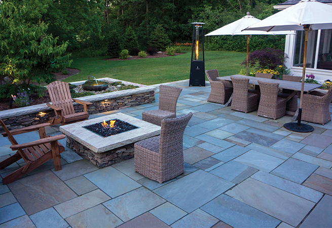 The full color range of bluestone patio, raised planter, and dry-laid fieldstone walls.