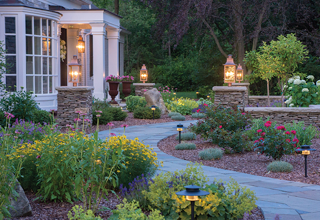 Dry stacked fieldstone columns, bluestone walkway and plantings.