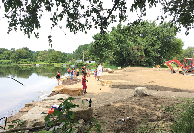Area youth fishing class  exploring the newly exposed lakeside.