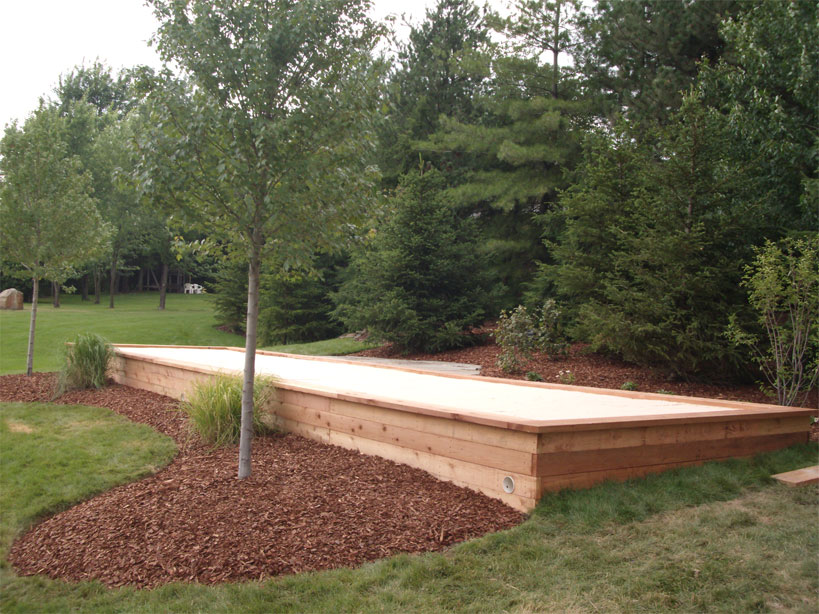 bocce court was built in an underused area of the clients backyard